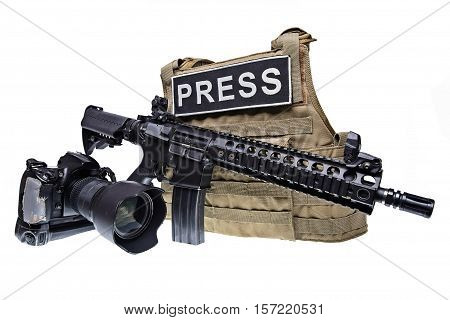 Bulletproof vest for journalistassault rifle and digital camera isolated on white background.Selective focus