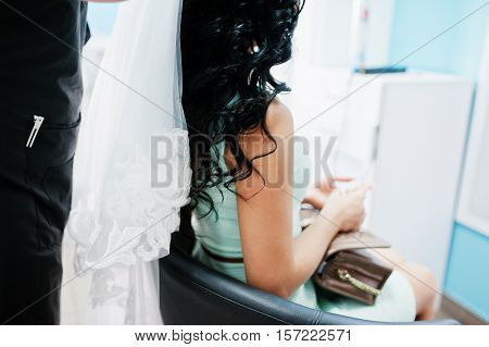 Professional Hairdresser Puts A Veil On The Head Of  Beautiful Brunette Model At Salon Of Beauty