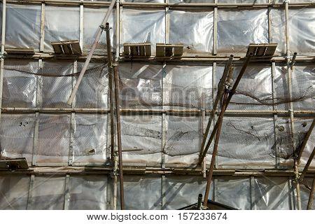 restoration facade of old house under net