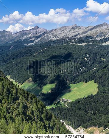 Alpen Mountains with Blue Sky and Clouds, Border of Austria and Italy