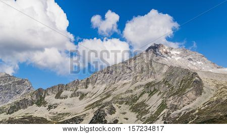 Rocky Alpen Mountains with Blue Sky and Clouds