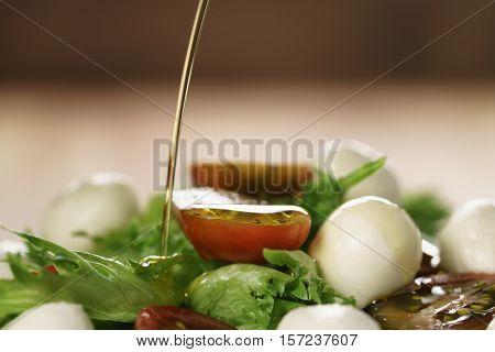 salad with kumato tomato, mozzarella and frillies lettuce, shallow focus