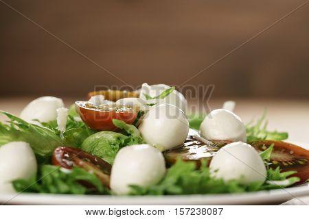 salad with kumato tomato, mozzarella, frillies lettuce and grated parmesan, shallow focus