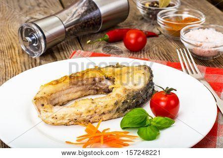 Fried white fish steaks on White Plate. Studio Photo