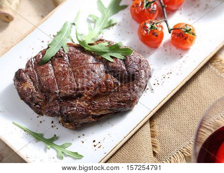 The steak from beef is served on a table