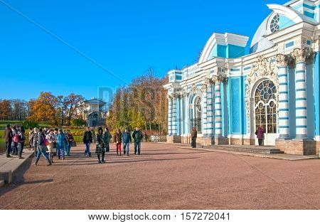 TSARSKOYE SELO, SAINT - PETERSBURG, RUSSIA - OCTOBER 19, 2016: People near The Grotto Pavilion next to The Great Pond in the Catherine Park. On the background is The Cameron Gallery