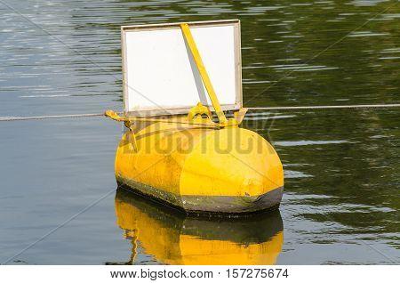 Navaid ton buoy yellow black indicates a danger point