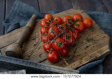 Cherry tomatoes. Cherry tomatoes on the vine in the decoration closeup