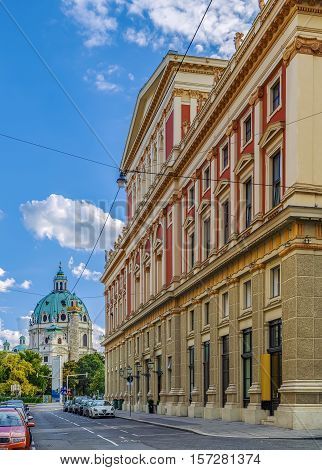View of street with Musikverein concert hall and St. Charles Church Vienna Austria