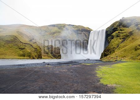 Skogafoss beautiful and powerful waterfall. This place is a famous natural landmark of Southern Iceland