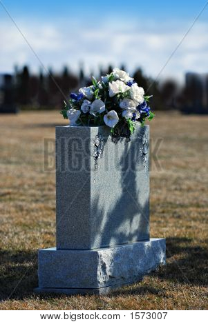 Headstone With Bouquet Marking Grave