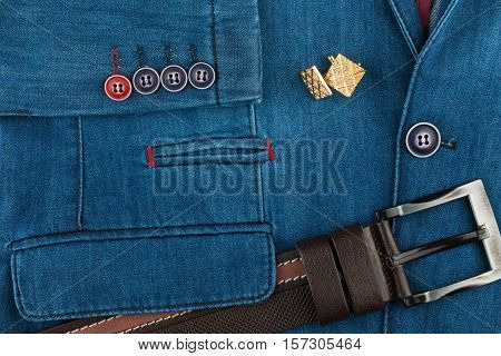 Denim suit brown leather belt and cufflinks. Fashion background. Top view