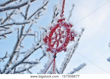 Frosty tree branches with Chinese wind chime