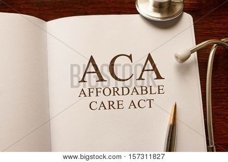 Page with ACA Affordable Care Act on the table with stethoscope medical concept