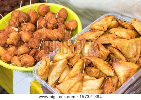 Street food - stuffed pastry and donuts from the Ivory Coast.
