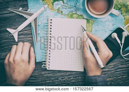 travel planning tourism traveler plan holiday lay desk flat tourist booking journey hand pointing plane trip woman concept - stock image