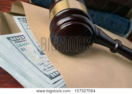 Bribe  in a court concept. A gavel and cash on a table.
