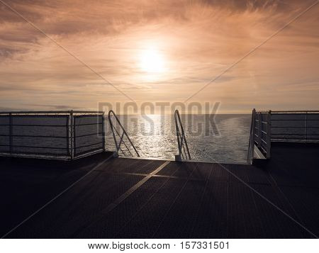 View on a warm sunset from a ferry ship crossing the Channel between Europe and UK