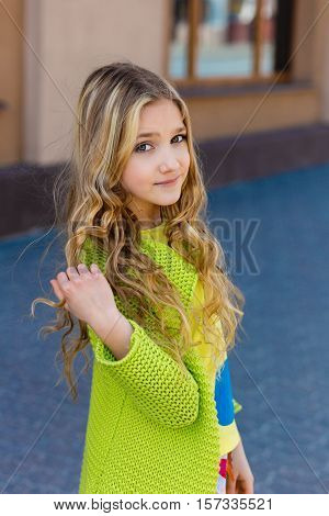 Blond Curly Girl In Green Looking At You