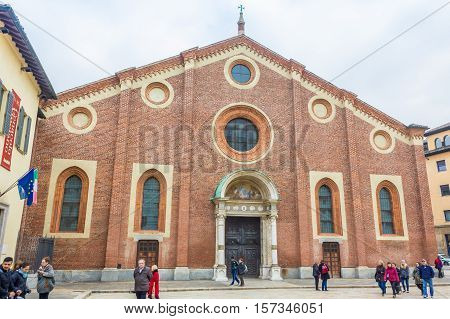 Milan, Italy - November 15, 2016: Santa Maria Delle Grazie, the Milan's famous church hosting The Last Supper painting, by Leonardo da Vinci in it's refectory. external with tourists visiting.