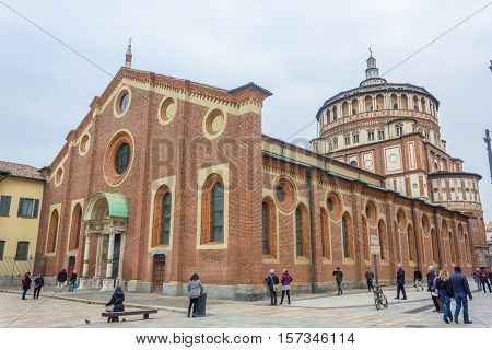 Milan, Italy - November 15, 2016: Milan's famous church Santa Maria Delle Grazie, hosting in it's refectory, The Last Supper mural painting by Leonardo da Vinci. side view