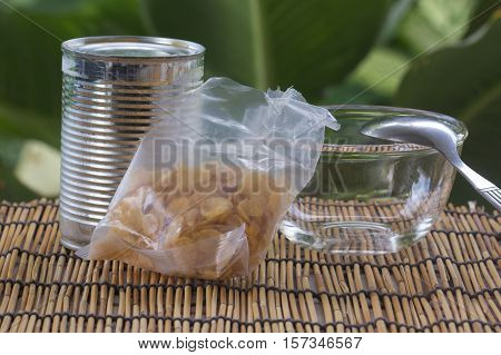 cornflakes and can of milk with cup