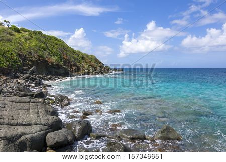 Rocky coastline and turquoise blue water on northeast coast of Isla Culebra in Puerto Rico on sunny day