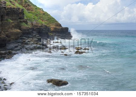Waves from the open Caribbean Sea pound rocky cliffs of Punta Flamenco on Isla Culebra in Puerto Rico