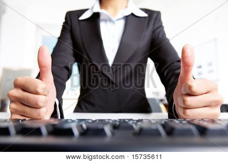 Photo of secretary showing thumbs up