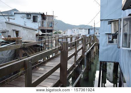 Hong Kong, China - Wooden bridge and floating houses in Tai O village