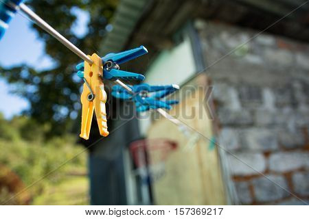 Clothespins on a rope. Colorful plastic clothes pegs
