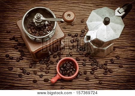 Old coffee maker with coffee bean in vintage style