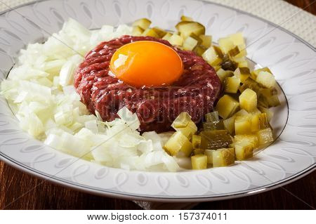 Steak Tartare With Egg Yolk, Onions And Pickles