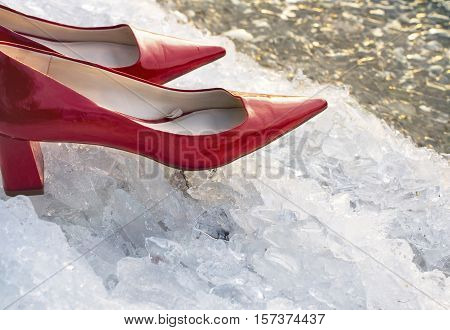 Red high heels on the ice and snow particular focus filtered shot