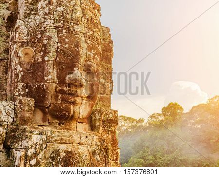 Enigmatic Giant Stone Face Of Bayon Temple In Evening Sun