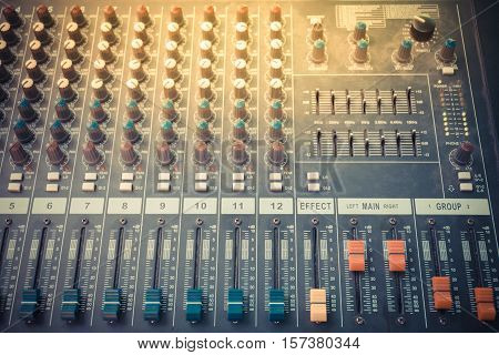Sound mixer control board with volume buttons. process in vintage style