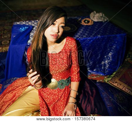 young pretty asian girl in bright colored fairy salon interior on carpet vietnamese, lifestyle different nation concept close up