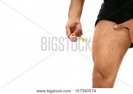 Muscular man injecting steroids, closeup