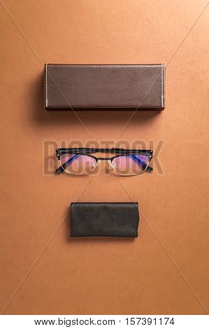 Brown eyeglasses eyewear frame and fabric over brown background top over head