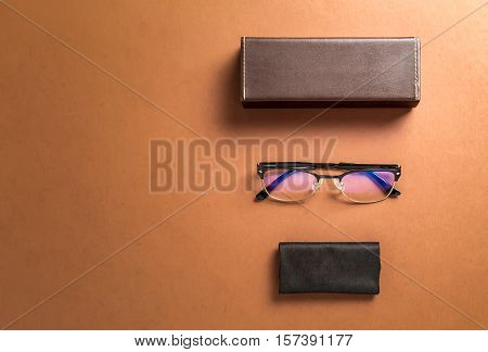 Brown eyeglasses eyewear framefabric and copy space for text or other over brown background top over head