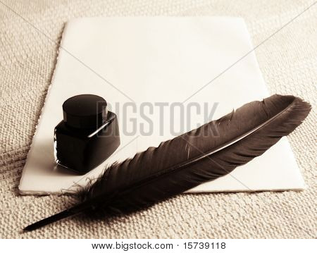 feather quill and inkwell