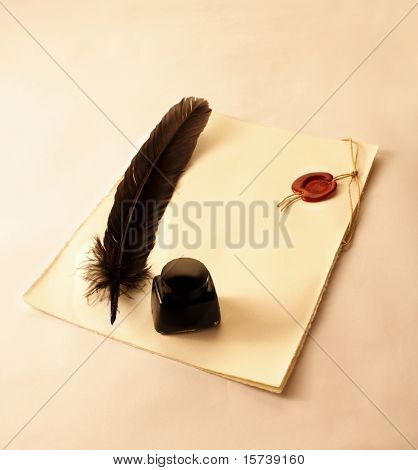 Parchment scroll with sealing wax, inkwell and quill