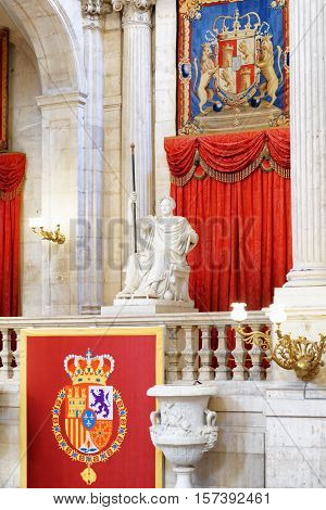 The Coat Of Arms Of The King Of Spain And A Sculpture In The Interior Of The Royal Palace Of Madrid