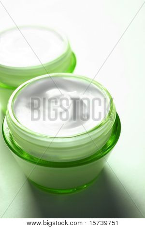 Close-up of open jar of face cream. cosmetic products with no brand