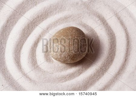 zen garden. Macro of a stone on raked sand