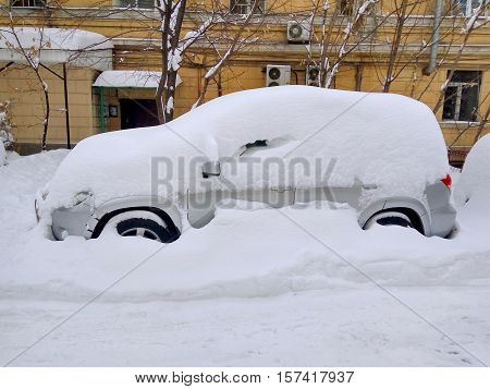 Car under the snow. Roads are blocked