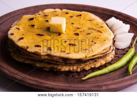 corn flour flat bread or roti or Makki Ki Roti with sarso da Saag or mustard leaves curry, Indian Food popular in winter season in north india