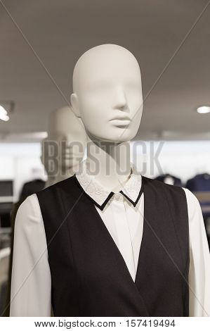 mannequin in a clothing store dressed in a classic style