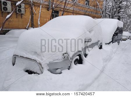 Cars under the snow. Roads are blocked
