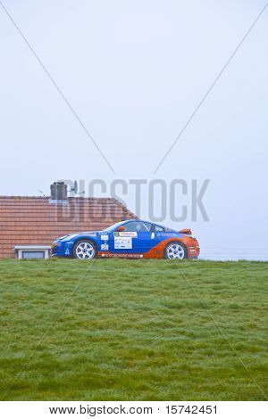Rally Car Racing In The Fog